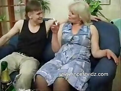 Busty mommy engaged in an BDSM affair with two wild