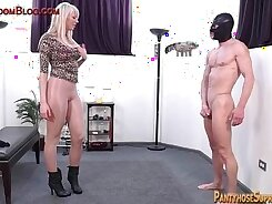 Blonde femdom shows dick during domination