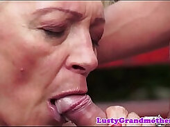Agreeable and mature nymphos taking turns sucking dick outdoors