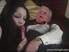 Beautiful tanned young slut serves an Arab dude on a black couch