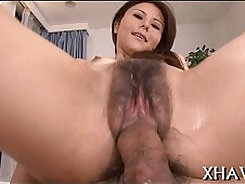 Asian gal sucks two dicks at once in this hot threesome session