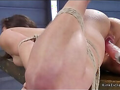Brunette fucked by machine and facial