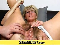 Close-up with hairy cunt fingering pussy