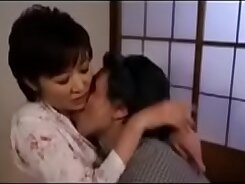 Japanese girl teaches mother how to suck dick in a bar