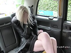 Blonde woman gives footjob in a taxi
